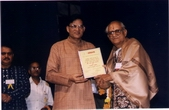 Pt. S.S. Pandey receiving 'Sangeet-Rishi' Samman from Dr. Mukesh Garg,... Founder-director of Sangeet Sanklap
